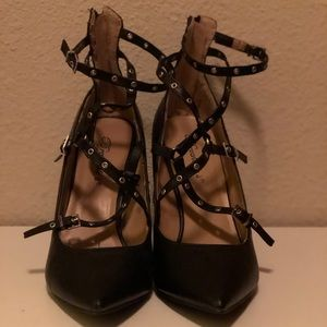 Brand new. Only tried on once. Black strappy heels